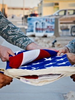 Members of the base honor guard fold the American flag during a prisoners of war and missing in action remembrance ceremony at the 379th Air Expeditionary Wing in Southwest Asia, Sept. 21, 2013. In the United States, National POW/MIA Recognition Day is observed on the third Friday in September and honors those who were prisoners of war and those who are still missing in action. The day was established by an Act of Congress and is one of six days the POW/MIA flag can be flown. (U.S. Air Force photo/Staff Sgt. Benjamin W. Stratton)