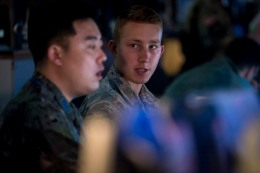 U.S. Air Force Senior Airman Ivan Cooper, right, and Republic of Korea Air Force 1st Lt. Jaewon Yoo with the Osan Weather Squadron, left, discuss the day's weather before preparing their combined slides and briefing for the general during Key Resolve at Osan Air Base, Republic of Korea, March 20, 2017. Weather forecasts are critical as countless factors can contribute to the outcome of a mission. Weather specialists keep a constant watch over the forecast and conditions that can affect the safety of pilots and aircrew. These experts utilize the latest technology to predict weather patterns, prepare forecasts and communicate weather information to commanders and pilots so that every mission goes as planned. Cooper is with the 15th Operations Support Squadron at Joint Base Pearl Harbor-Hickam, Hawaii. (U.S. Air Force photo by Staff Sgt. Benjamin W. Stratton)